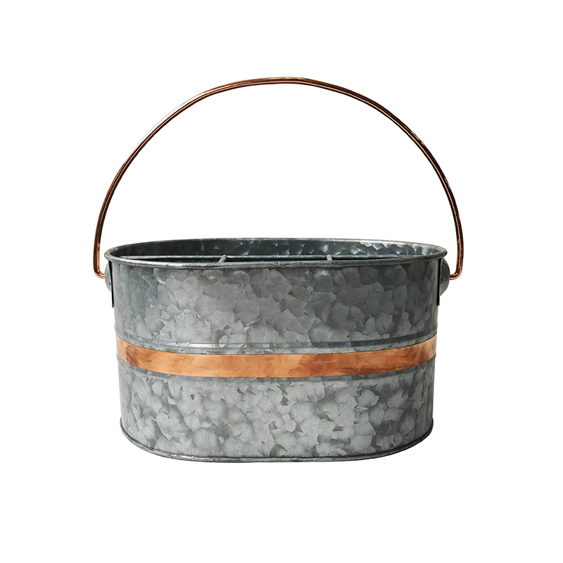 Galvanized metal utensil caddy with copper decor