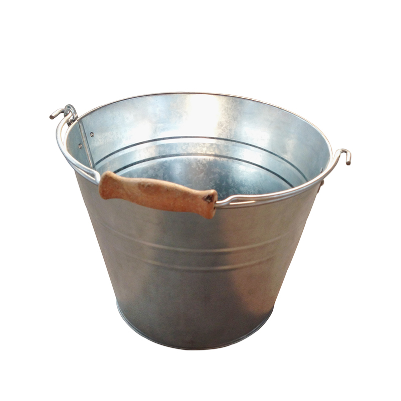 Galvanized metal bucket of water with wood handle